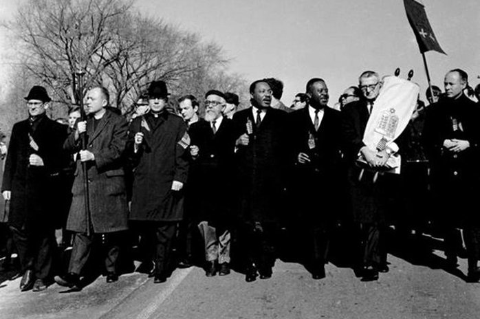 Rabbi Abraham Joshua Heschel guides Dr. Martin Luther King Jr. in the 1965 March on Selma
